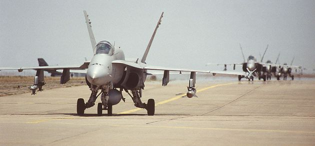 U.S. Navy FA-18 Hornet leads other Hornets as they taxi towards the de-armament area set up at the Roswell, N.M