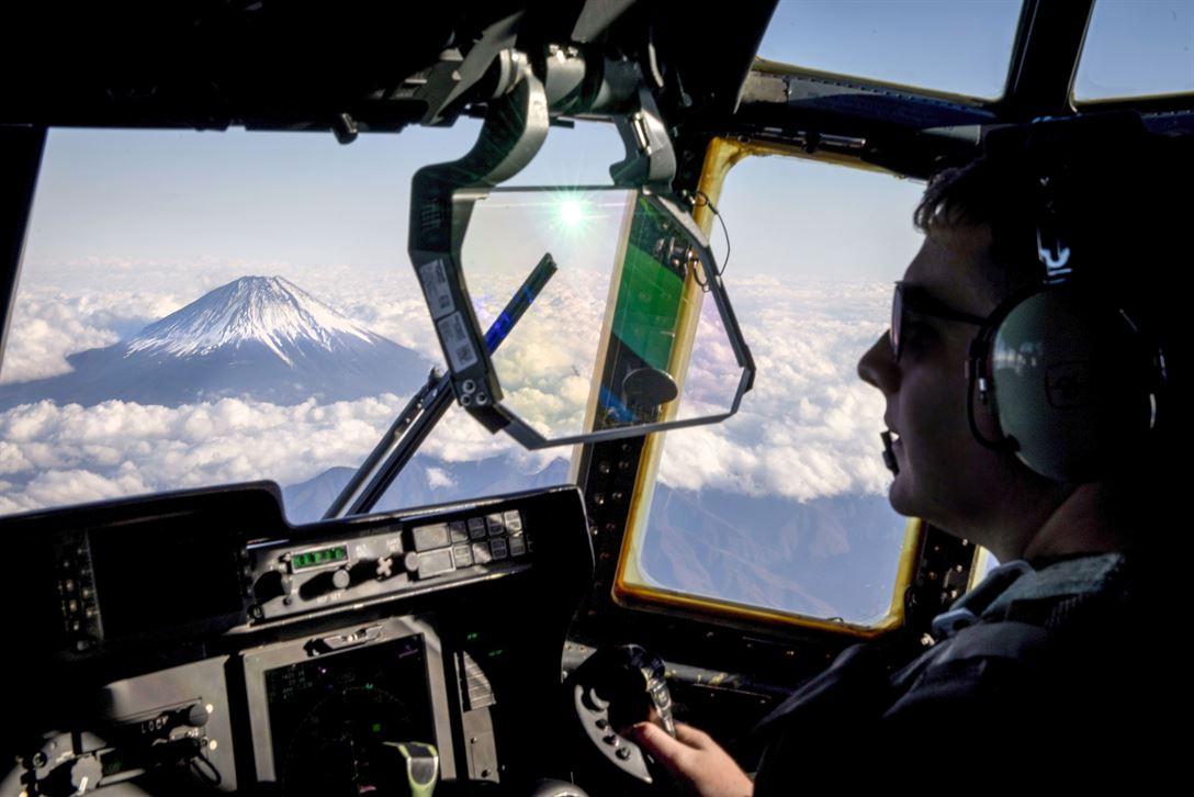 Air Force Capt. Kyle Schneider, a C-130J Super Hercules pilot, flies near Mount Fuji