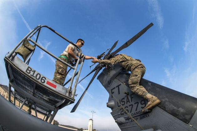 Airmen prepare the tail of an HH-60G Pave Hawk helicopter at Moody Air Force Base