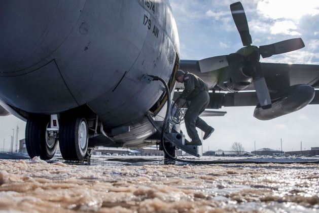 Air Force Tech. Sgt. Chris Brandal Inspects a C-130H Hercules in Bitter Cold