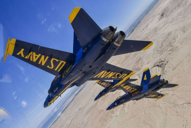 Blue Angels, the Navy's flight demonstration squadron, practice show maneuvers during a winter training flight over El Centro, Calif