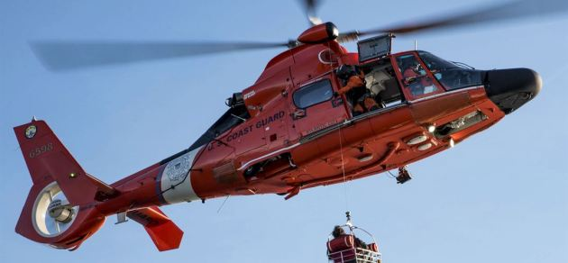 Coast Guard MH-65 Dolphin Rescue Helicopter Medevacs Distressed Fisherman