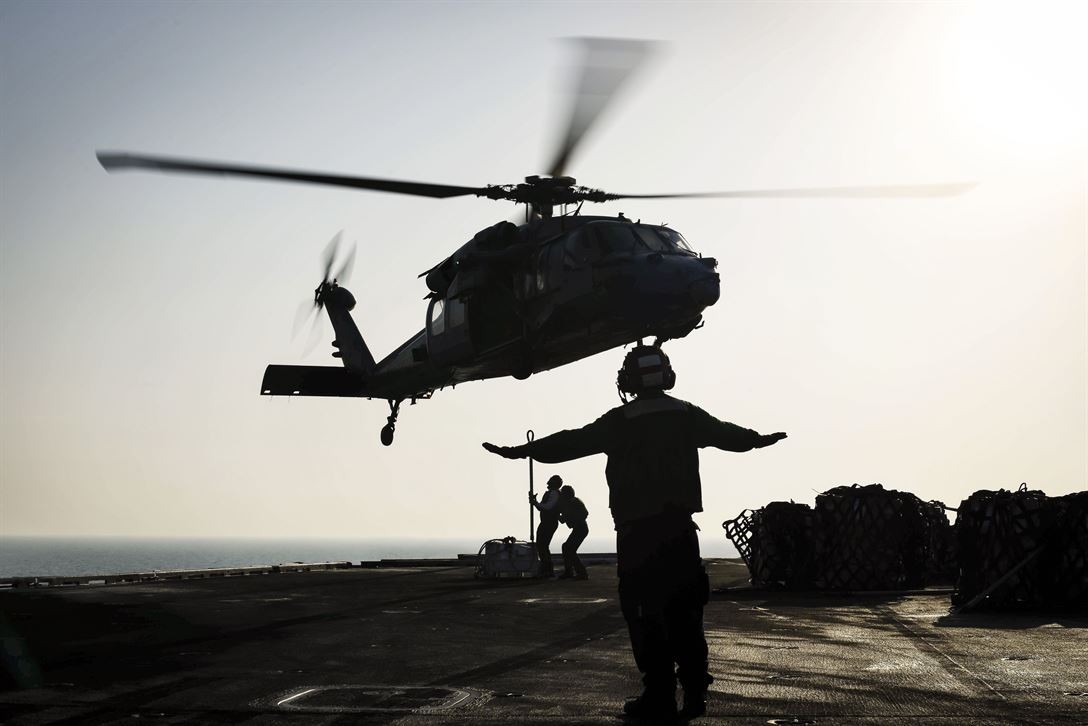 Sailors Attach Cargo to an MH-60S Seahawk Helicopter