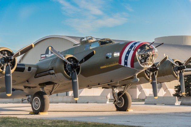 B-17F Memphis Belle poses for photos before moving into the WWII Gallery at the National Museum of the United States Air Force