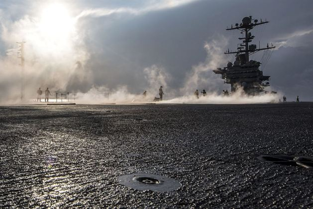 Sailors test a catapult on the flight deck of the USS Harry S. Truman