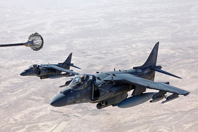 U.S. Marine Corps AV-8B Harrier aircraft attached to Marine Attack Squadron (VMA) 311 are refueled by a KC-130J Hercules aircraft