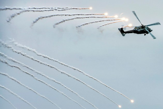 Navy MH-60S Seahawk Helicopter Fires Flares