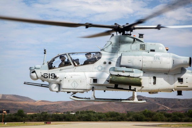 AH-1Z Viper Helicopter Hovers During a Pre-flight Inspection