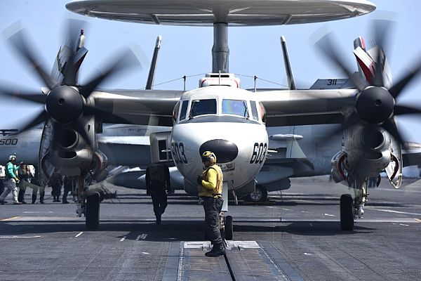 Aviation Boatswain's Mate 3rd Class John Gandy Positions an E-2D Hawkeye