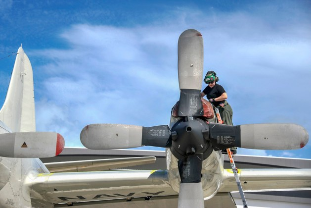 Navy Petty Officer 2nd Class Melissa Ellis Fastens a Propeller on a P-3C Orion