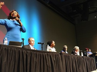 Dorothy Brown stands up to speak at the affordable housing forum on December 11, 2018.