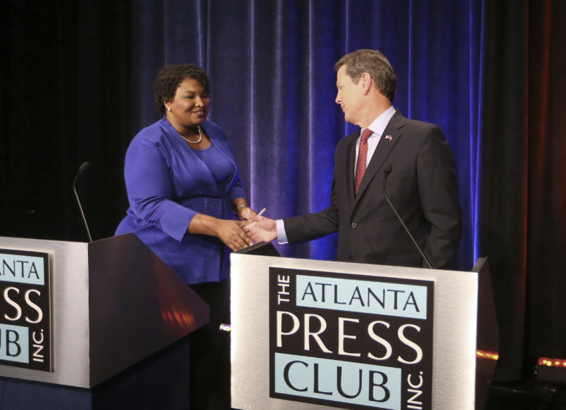 Democrat Stacey Abrams shakes the hand of Republican Brian Kemp before a debate on October 23 during the Georgia gubernatorial race.