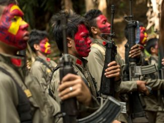 Fighters from the New People's Army stand in formation in the Sierra Madre mountain range, located east of Manila, the capital of the Philippines.