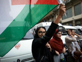 Woman holding Palestine flag
