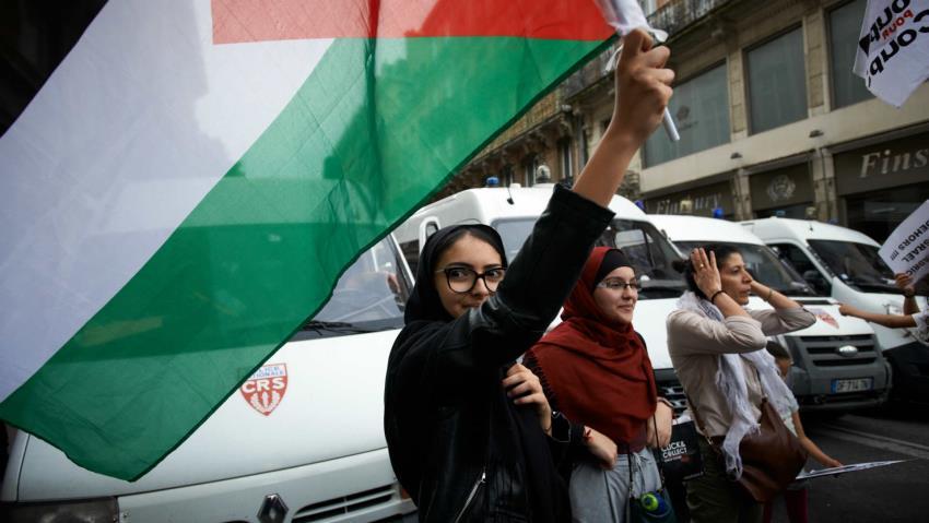 Woman holding Palestine flag