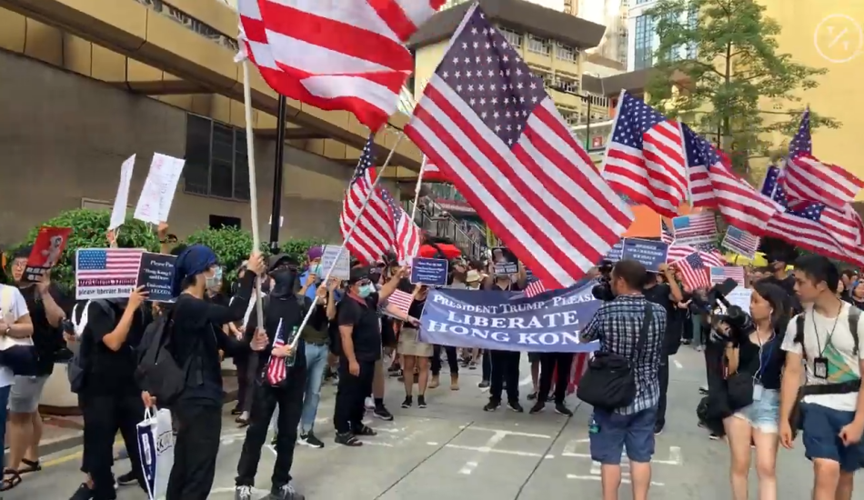 Hong Kong protesters wave U.S. flags