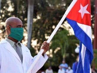 Medical worker with Cuban flag