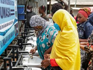 African women in Tanzania wash hands during COVID-19 pandemic