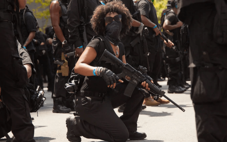 https://i2.wp.com/fighting-words.net/wp-content/uploads/2020/08/NFAC-militia-members-march-with-arms.png?ssl=1