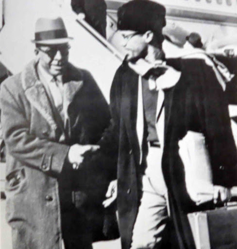 Malcolm X greeted by Atty. Milton Henry during his final trip to Detroit on Feb. 14, 1965