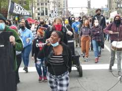 Detroit May Day 2021 marching down Woodward avenue