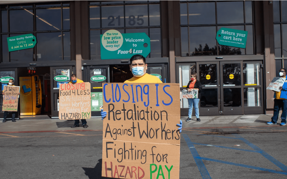 Protesters rally in solidarity with essential workers against Kroger Co 's plan to shutdown stores