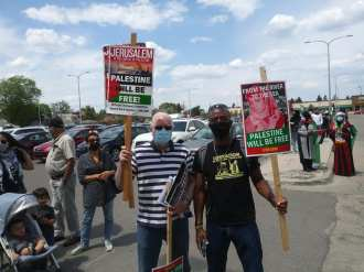 Dearborn demonstration with MECAWI members holding their placards, May 15, 2021