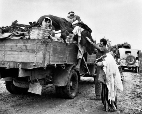 Palestinian refugees in flee in the aftermath of the Deir Yassin massacre in 1948
