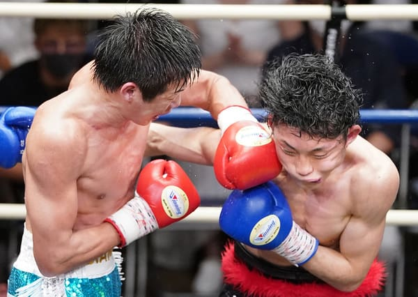 Shimizu Connects With A Overhand Southpaw Left To Mori
