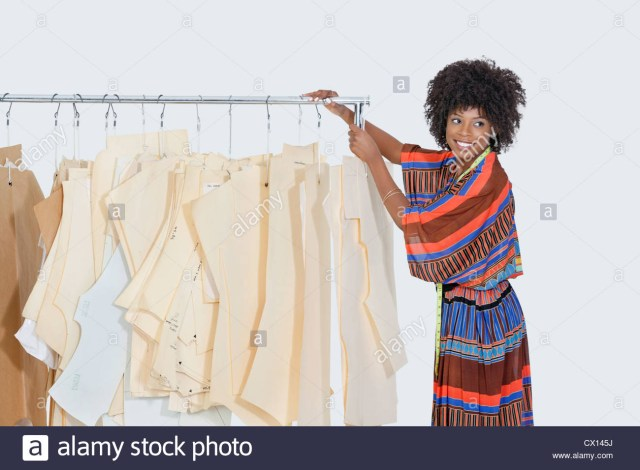 Designer Sewing Patterns African American Female Designer With Sewing Patterns On Clothes