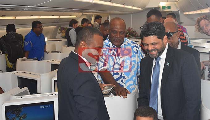 Attorney General Aiyaz Sayed-Khaiyum with guests on board the Fiji Airways A350 during the arrival ceremony at the Nadi International Airport yesterday. Photo: WAISEA NASOKIA