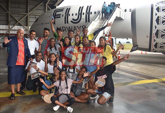 Prime Minister Voreqe Bainimarama with students at the Fiji Airways Airbus A350 Arrival Ceremony at the Nadi International Airport yesterday. Photo: WAISEA NASOKIA