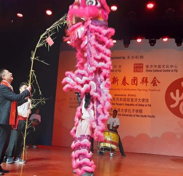 Chinese Ambassador to Fiji Qian Bo feeds the dancing lion at the marking of the Chinese New Year - The Year of the Rat at the Suva Civic Centre on January 19, 2020. Photo: Shalveen Chand