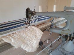 sauterelle pour coudre les couettes en laine