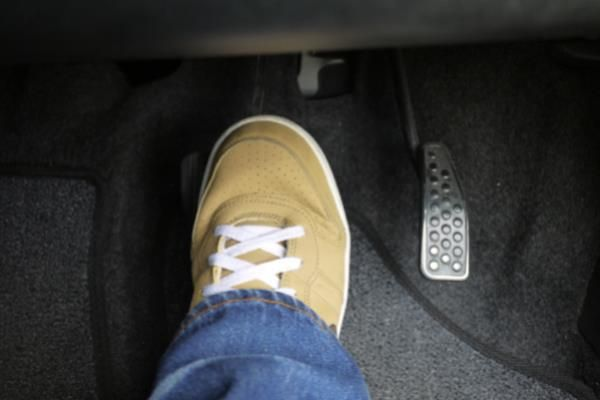 Right foot on the brake pedal
