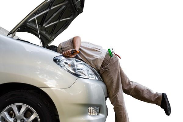 A man checking the car engine