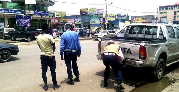 2 policemen is checking a man's vehicle