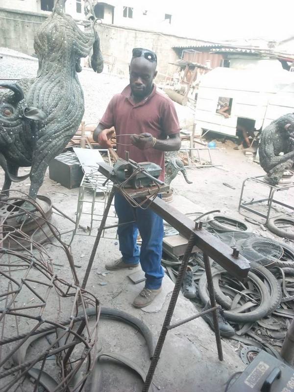 artist-making-art-from-tire