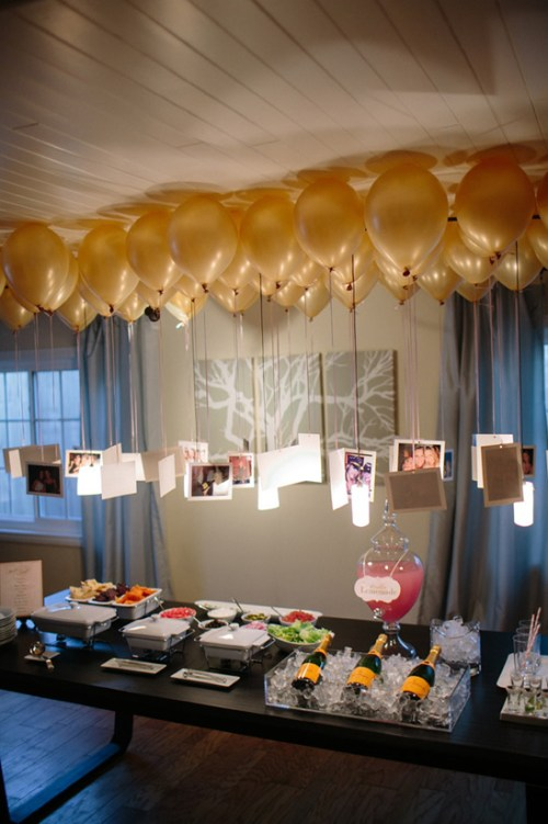 Balloon Decorations Pictures On Balloons Gold Balloons Above Table Display Food Appetizers and Wine On Table