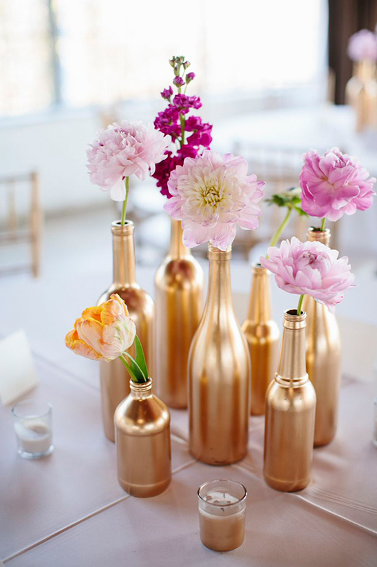 gold painted bottles make pretty flower vases