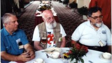 Dick Spelman, Art Widner, and Bruce Pelz -- all gone now -- at a Midwestcon banquet. Photo copyright © Andrew Porter