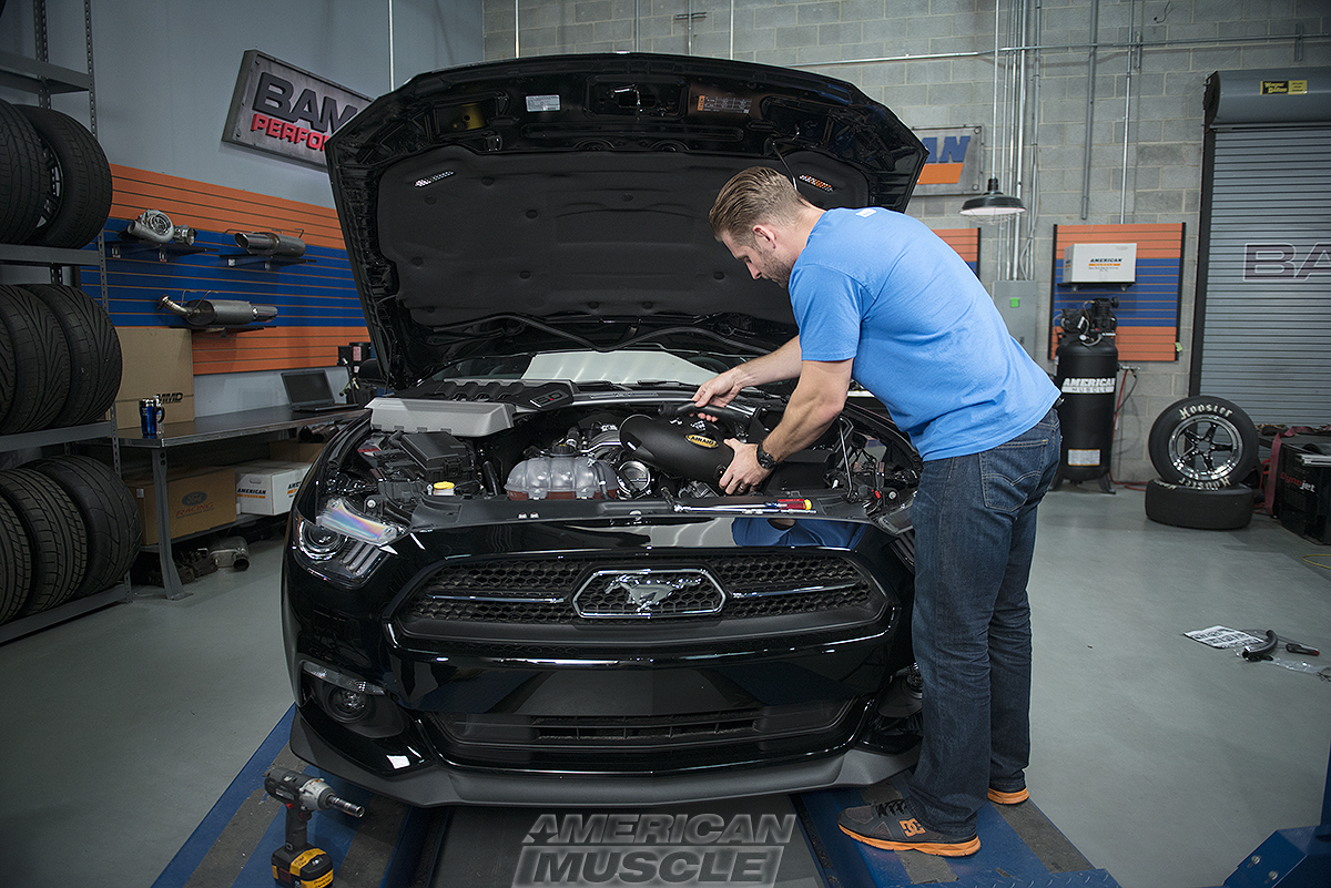 Justin Dugan wrenching on a 2015 Mustang GT