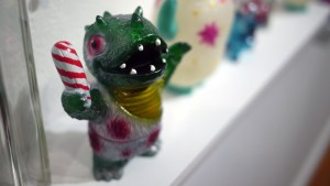 Bleeding Edges' Festive Caveman Dinosaur from Gift Wrapped 2016 at The Clutter Gallery