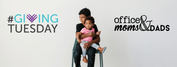 A little boy sits on a chair looking scared holding his toddler sister