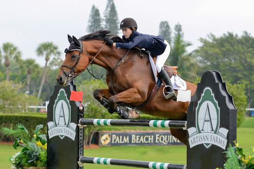 At only 15 years of age, Lucy Deslauriers of the United States topped the 2015 Artisan Farms Under 25 Grand Prix Series riding Hester.  Photo Credit - Starting Gate Communications