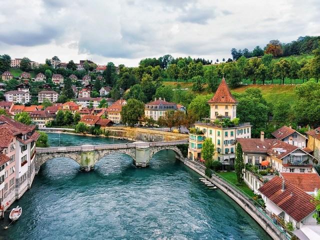 Unterbrucke bridge over Aare River and old houses in Bern Switzerland