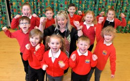 Mrs Angela Clark with pupils of Filey Church of England Nursery and Infants Academy, celebrating their 'Good' rating from school inspectors Ofsted.