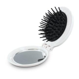 La brosse à cheveux fille au guidon est compacte pour se glisser dans les poches de toutes les motardes