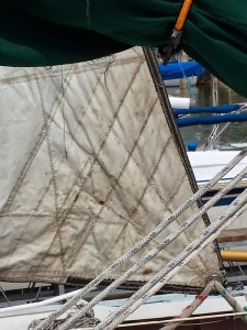 The sail clew, unfurled.