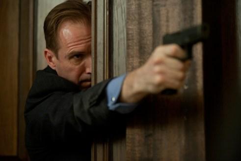 Ralph Fiennes Skyfall Holding Gun